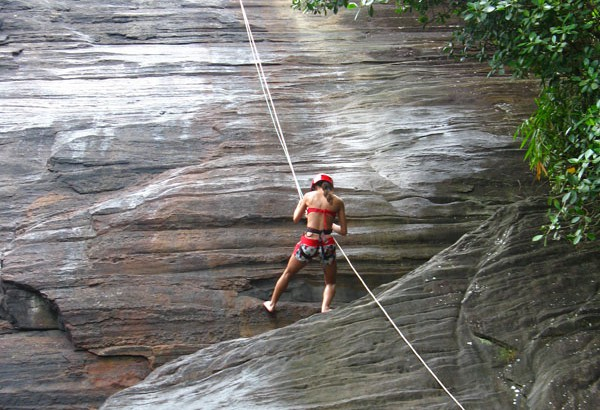 Climbing rock wall with rope
