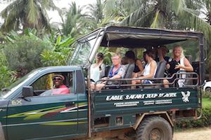 Ali driving a Jeep